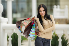 Happy woman with shopping bags. Stock Photo