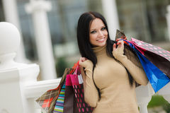 Happy woman with shopping bags. Stock Images