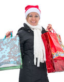 Happy woman with shopping bags before Christmas, isolated Royalty Free Stock Photography
