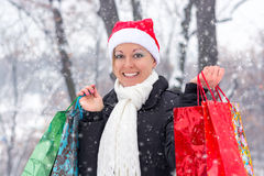 Happy woman with shopping bags before Christmas Royalty Free Stock Photography