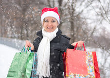 Happy woman with shopping bags before Christmas Royalty Free Stock Photo