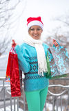 Happy woman with shopping bags before Christmas Stock Photography