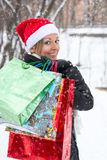 Happy woman with shopping bags before Christmas Royalty Free Stock Image