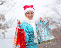 Happy woman with shopping bags before Christmas Stock Image