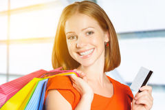 Happy woman on shopping with bags and credit cards, christmas sa Stock Photos