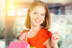 Happy woman on shopping with bags and credit cards, christmas sa Royalty Free Stock Photo