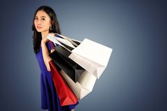 Shopping woman with a shopping bags stock photography
