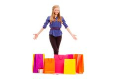 Happy woman with shopping bags on the floor Stock Images
