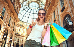 Happy woman with shopping bags in Galleria Vittorio Emanuele Stock Photos