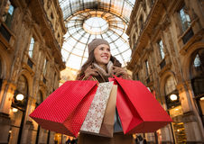 Happy woman with shopping bags in Galleria Vittorio Emanuele II Royalty Free Stock Photography