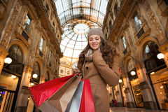 Happy woman with shopping bags in Galleria Vittorio Emanuele II Royalty Free Stock Photo