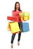 Happy woman with shopping bags and gifts Royalty Free Stock Photos