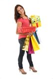 Happy woman with shopping bags and gifts Stock Photo