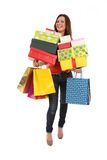 Happy woman with shopping bags and gifts Royalty Free Stock Image