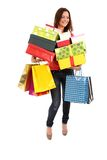 Happy woman with shopping bags and gifts Stock Images