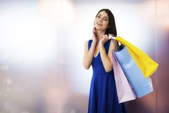 Happy woman with shopping bags in hand. Happy smiling woman with shopping bags in hand royalty free stock image