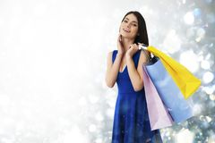 Happy woman with shopping bags in hand stock photography