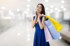 Happy woman with shopping bags in hand. Happy smiling woman with shopping bags in hand stock image