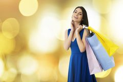 Happy woman with shopping bags in hand. Happy smiling woman with shopping bags in hand royalty free stock photos