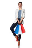 Happy woman with shopping bags posing against white background Royalty Free Stock Images