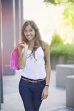 Happy woman with shopping bags Stock Photos