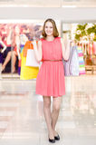 Happy woman with shopping bags  in a supermarket Royalty Free Stock Image