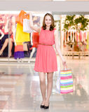 Happy woman with shopping bags in a supermarket Royalty Free Stock Images