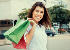 Happy woman with shopping bags in vintage cinema look Stock Photos
