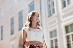 Happy woman with shopping bags walking in city Stock Photography