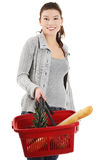 Happy woman with shopping basket Stock Photo