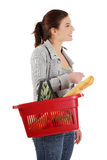 Happy woman with shopping basket Stock Images