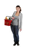 Happy woman with shopping basket Royalty Free Stock Photography