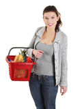 Happy woman with shopping basket Royalty Free Stock Image