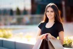Happy Woman Shopping on Big Summer Sale. Cool girl taking advantage of summertime discounts royalty free stock image