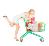 Happy woman with shopping cart and bags Royalty Free Stock Photography