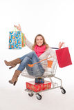 Happy woman in shopping cart Stock Photos