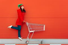 Happy Woman with Shopping Cart Ready for Christmas Sale stock photography