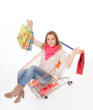 Happy woman in shopping cart Stock Images