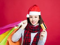 Woman shopping for christmas gifts by credit card Royalty Free Stock Photos