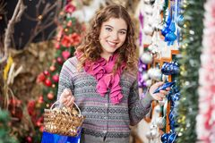 Happy Woman Shopping For Christmas Ornaments Royalty Free Stock Photo