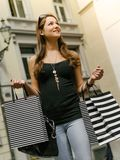 Happy woman shopping in the city Stock Photos