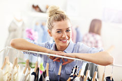 Happy woman shopping for clothes royalty free stock images