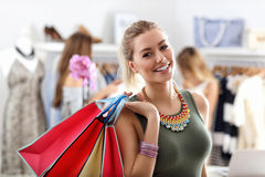 Happy woman shopping for clothes Stock Photography