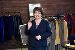 Happy woman shopping in clothes store Royalty Free Stock Images