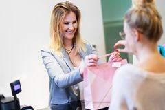 Happy woman shopping for clothes in store royalty free stock photos