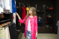 Happy woman shopping in clothing store Royalty Free Stock Photos