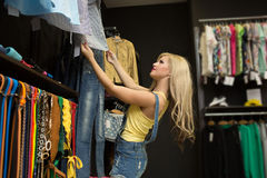 Happy woman shopping in clothing store Royalty Free Stock Photo