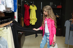 Happy woman shopping in clothing store Stock Photo