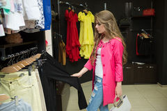 Happy woman shopping in clothing store Stock Image