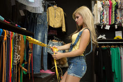 Happy woman shopping in clothing store Stock Photography